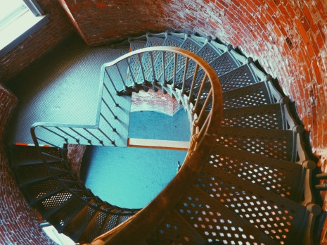 Down the stairs.